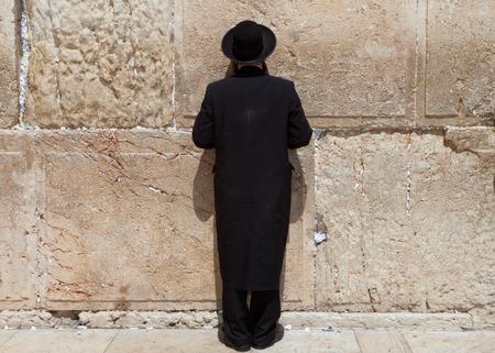 hasid: Orthodox Jewish Man prays at the western wall, Jerusalem Stock Photo