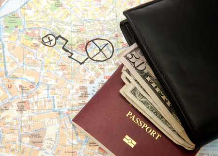 Travel Arrangement of Wallet Dollar notes passport and Map photo