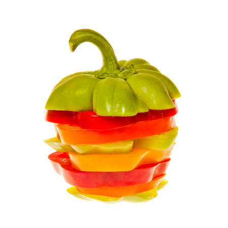 Stack of Sliced Red Yellow Green and orange bell peppers photo