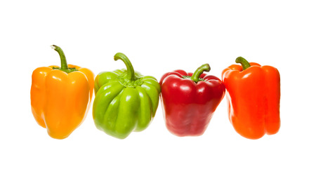 Green red yellow and orange bell peppers photo