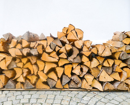 Wood logs with white wall background Stock fotó