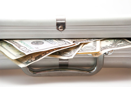 Silver suitcase with Dollar notes showing photo