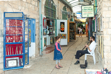 ashkenazi: Tourists walk by shops and art galleries in Safed s old city alleys