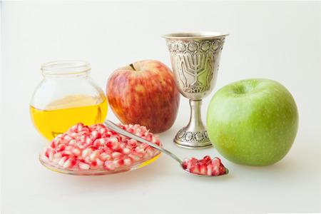 rosh hashana: Rosh hashana Kiddush cup honey pomegranate and sliced apple Stock Photo