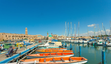 akko: Port of Acre, Israel. with boats and the old city in the background.