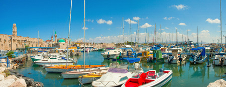 Port of Acre, Israel. with boats and the old city in the background. Banco de Imagens - 31472160