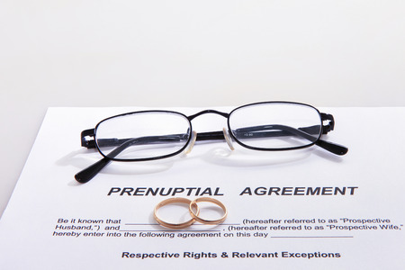 Prenuptial agreement with rings Banco de Imagens
