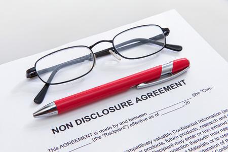 Non disclosure agreement with pen and glasses Archivio Fotografico