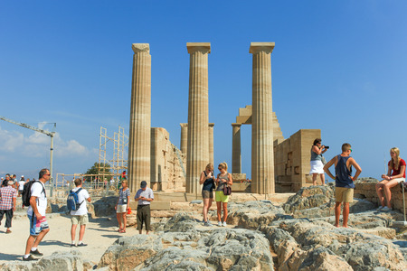 successively: Tourists at the top of Lindos ancient Acropolis ruins, a natural citadel which was fortified successively by the Greeks, the Romans, the Byzantines,and the Ottomans. Editorial