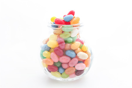 Jelly beans with a glass jar photo