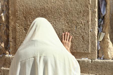 Orthodox Jewish man pray at the Wailing wall photo