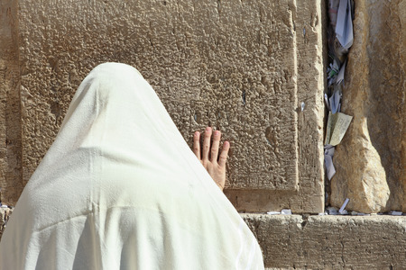 Orthodox Jewish man pray at the Wailing wall