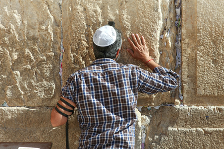 western wall: Man pray at the wailing wall, Jerusalem Israel