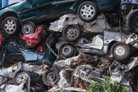 salvage yards: Scrap yard with crushed cars and blue sky