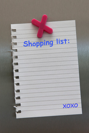 fridge: Shopping list note on a fridge door with magnet