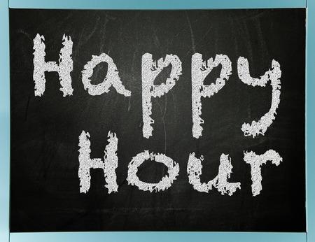 Happy hour sign on chalkboard Archivio Fotografico