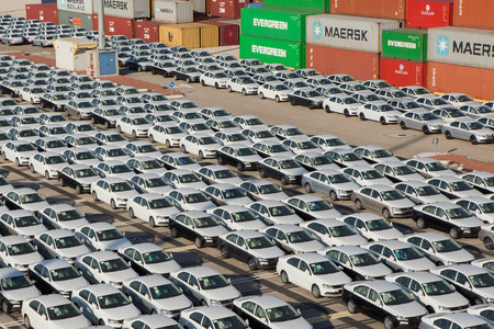 Rows of new cars parked in an international port Editorial