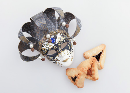 purim mask: Traditional Jewish holiday - Purim Hamantaschen and mask Stock Photo