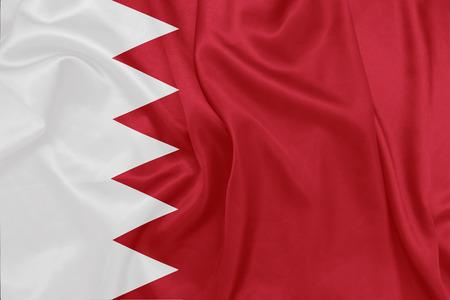 bahrain: Bahrain - Waving national flag on silk texture Stock Photo