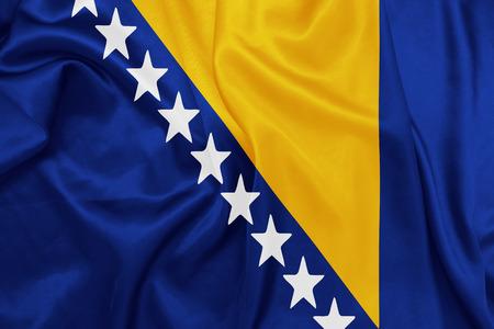 bosnia and herzegovina flag: Bosnia and Herzegovina - Waving national flag on silk texture Stock Photo