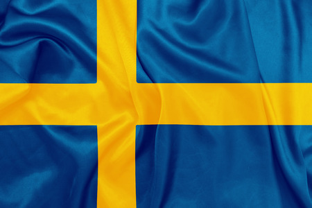 national colors: Sweden - Waving national flag on silk texture Stock Photo
