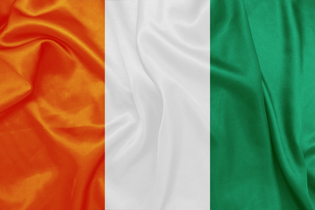 ivory: Ivory Coast - Waving national flag on silk texture