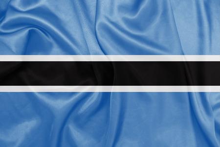 botswana: Botswana - Waving national flag on silk texture Stock Photo