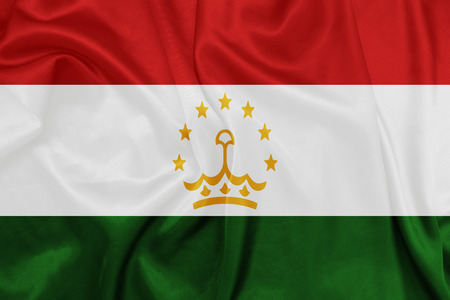 tajikistan: Tajikistan- Waving national flag on silk texture Stock Photo