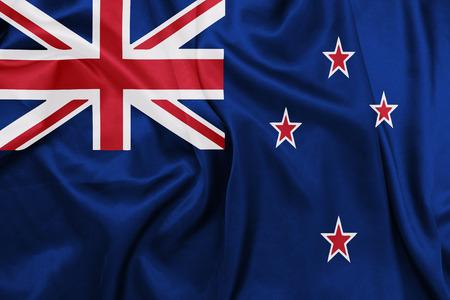 bandera de nueva zelanda: Nueva Zelanda - Ondeando la bandera nacional en la textura de la seda Foto de archivo