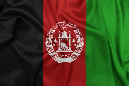afghan flag: Afghanistan - Waving national flag on silk texture