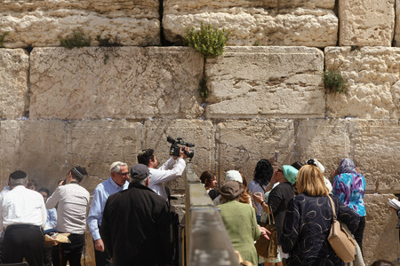 Women and tourists pray at the western wall Editorial
