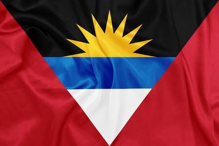 barbuda: Antigua and Barbuda - Waving national flag on silk texture