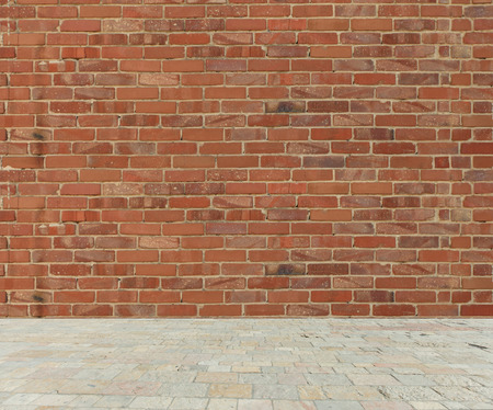 Old red brick wall with stone marble floor 스톡 콘텐츠