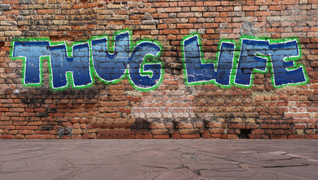 Thug life graffiti on a brick wall street scene