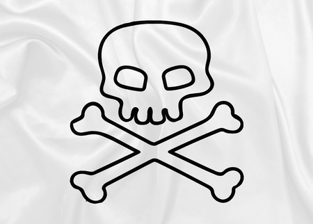 roger: Jolly Roger waving flag on silk texture Stock Photo