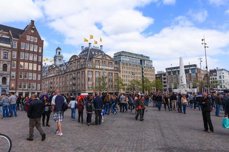 dam square: Locals and tourist at Amsterdams Dam square Editorial