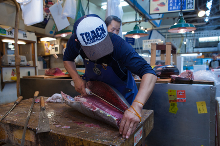 nijo: Fresh Tuna main cut by professional Japanese tuna handlers at Tsukiji fish and seafood market, right after the Tuna auction.