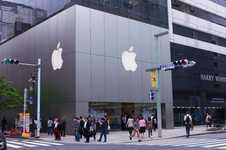 high end: People on Main street of High end Ginza district of Tokyo with the official Apple store.