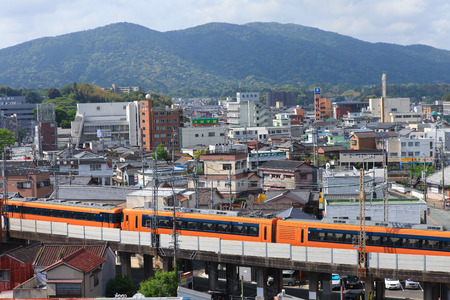 ise: Skyline and train crossing at the city of Ise Editorial