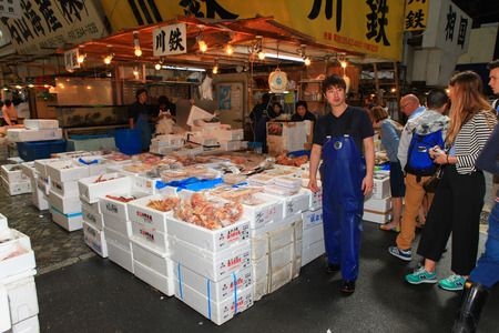 fish shop: Famous Tsukiji fish market shops. Tsukiji is the biggest fish market in the world with a vast varaiety of Fish and sea food