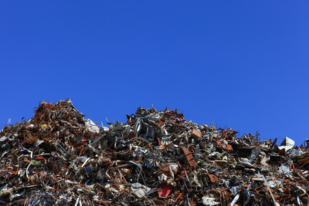 dump yard: Scrap metal yard with clear blue sky Stock Photo