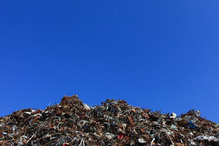 Scrap metal yard with clear blue sky Stock Photo