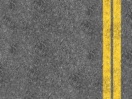 Asphalt with double yellow lines Фото со стока