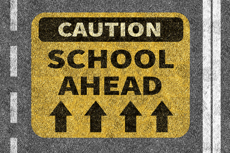 ahead: Road with School ahead caution sign Stock Photo