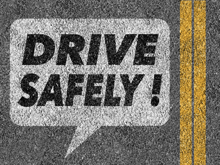 safety first: Road with speech bubble and Drive safely text