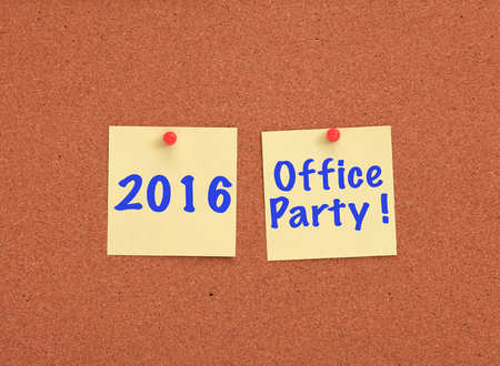 office party: Cork board with 2016 office party written on two yellow notes Stock Photo