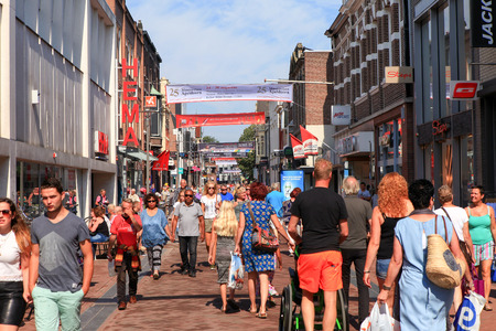 People at Apeldoorn Markstraat main street, known as a popular shopping street for locals and tourists.