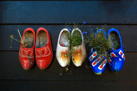 clogs: Colorful wooden clogs on dark wooden panels