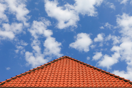 blue cloudy sky: Typical roof tiles with blue cloudy sky