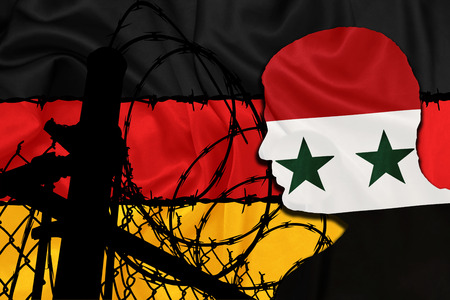 syrian: Syrian refugee shadow with the German flag and barbed wire